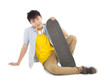 cool man sitting and holding a skateboard