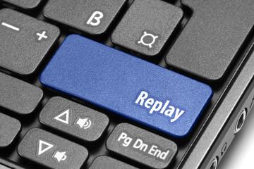 Replay. Blue hot key on computer keyboard
