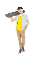 young man standing and holding a skateboard