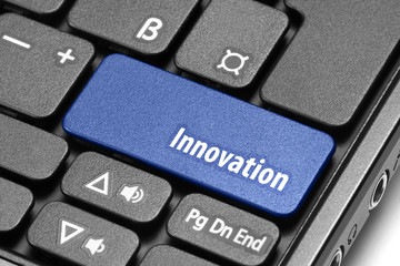 Innovation. Blue hot key on computer keyboard