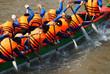 Team building activity,  rowing dragon boat racing - 64844431