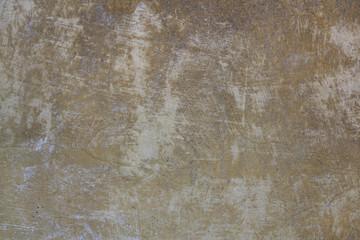 Hintergrundtextur von zerkratztem Wandputz