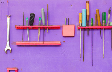 Mechanic tools set isolated on purple wall