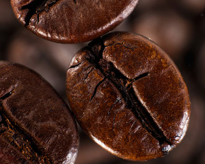 Cofee beans against blurred abstracr backgrounds
