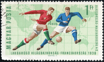 stamp showing illustration of soccer players
