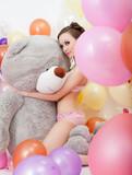 Image of sexy slim woman hugging big teddy bear
