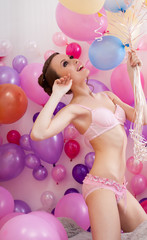 Sexy slim model posing in lingerie with balloons