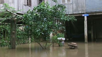 Courtyard of rural Khmer houses flooded , Cambodia,