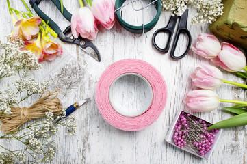 Florist workplace: woman making floral arrangements