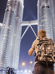 Young man photographing himself at Petronas Twin Towers