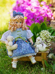Garden still life with collectable doll