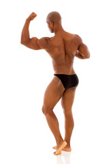 back view of black bodybuilder flexing muscle