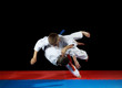 Two young athletes in the sharp drop perform judo throw - 64851804