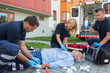 Paramedics giving firstaid to unconscious patient