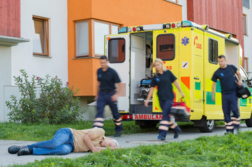 Emergency team running to unconscious man