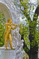 Golden statue of famous composer Johann Strauss,Stadtpark,Vienna