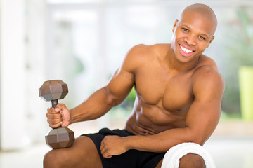 african man exercising at home