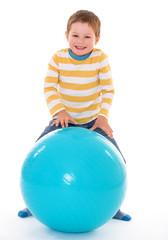 little boy with a big ball.