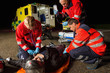 Emergency team helping injured motorbike driver