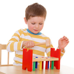 little boy playing at the table