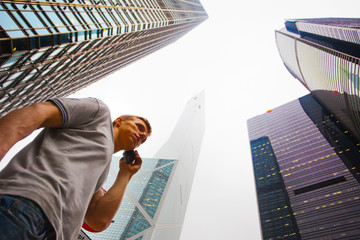 young man goes to Hong Kong and talking on mobile phone