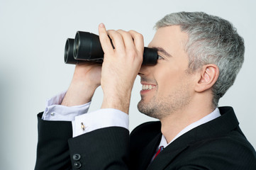 Young business man with binocular