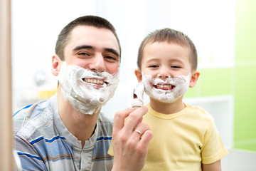 Father teaching his son boy how to shave