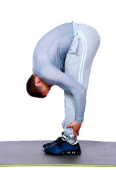 Stretching workout posture by a sports man over white background