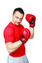 Sportsman in boxing gloves standing over white background