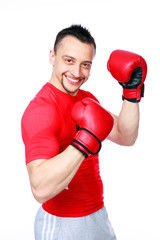 Smiling sportsman in boxing gloves standing