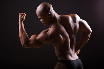african american bodybuilder showing muscles