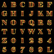 golden alphabet with red wood