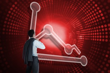 Composite image of graph and businessman looking