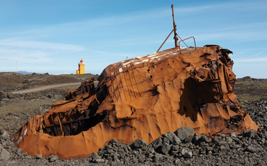 Iceland. Reykjanes Peninsula. Rusted vessel and volcanic ground.