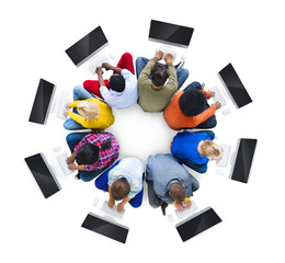 Multiethnic People Using Computers in a Circular Position