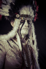 American Indian chief with big feather headdress