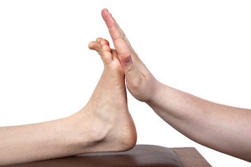 Hand presses against foot