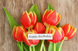 Happy Birthday card with red and yellow tulips