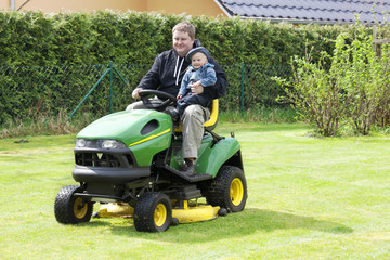 Man and child in the garden tractor