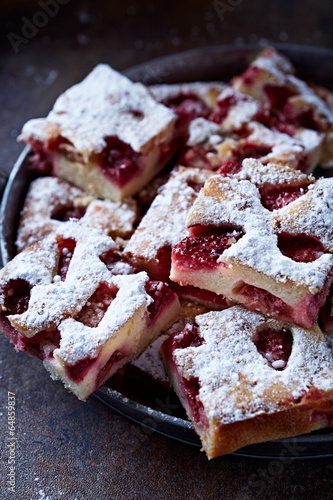 Raspberry and Rhubarb Cake Dusted with Icing Sugar - 64859837