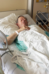 Senior in hospital bed vertical