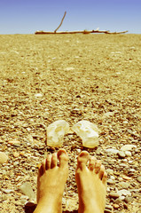bare feet in a shingle beach