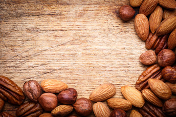 Background texture of assorted mixed nuts including cashew nuts,