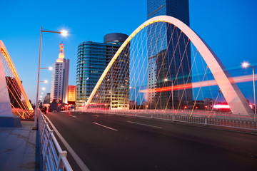 Arc bridge girder highway car light trails city night landscape