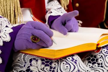 hands of sinterklaas with book