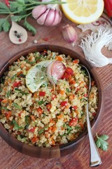 Quinoa salad with vegetables mix,lemon and thyme.