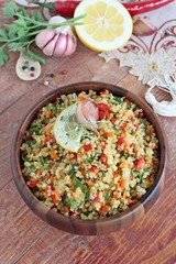 Quinoa salad with vegetables,lemon and thyme.