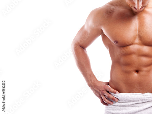 canvas print picture Muscular man in towel, isolated on white background
