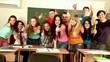 Group student near blackboard in classroom.