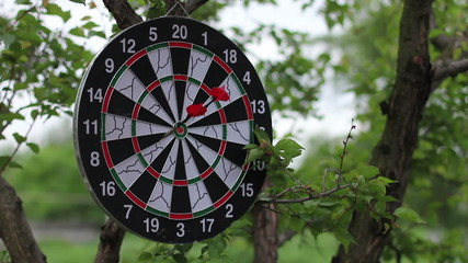 3 red darts arrow hits a target - HD 1080